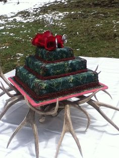 The perfect cake. But instead of red. I would use hunters orange and deer instead of the bow thing.
