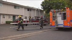 A woman was taking a shower when her water heater sparked a fire in an apartment complex Monday morning, firefighters said.