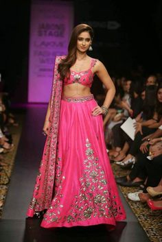Make your wedding dreams come true with this ravishing magenta pink raw silk lehenga choli featuring leafy appliqués (patch work). Adorned by the beautiful Bollywood actor Ileana D'Cruz, the ensemble includes a low-cut choli which gives it a contemporary Indian Wedding Fashion, Indian Wedding Outfits, Indian Bridal, Indian Outfits, Indian Clothes, Pakistani Clothing, Indian Party, Bridal Outfits, Bridal Dresses
