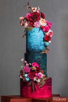 A cake for a couple with a wild side! | WedLuxe #Colours #WeddingCake #Cake #WeddingInspo #Blue #Pink #Pretty #CakeInspo #Fun