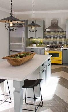 Denise McGaha Interiors | Portfolio Love the yellow stove, chevron wood floors, and modern, warm feeling.