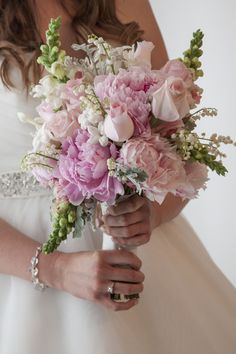 This pink bouquet is so beautiful! The flowers are well placed and add all the right colors!