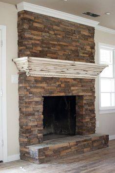 Fireplace update. Create a mantle that slips over the top of the existing brick and anchors to the wall on either side! I'm going to have somewhere to hang stockings this year!!! Now I need stockings...: