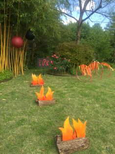 "Ninjago obstacle course - fire element.  Created by cutting out flames from foam board and adding spray paint.  We attached the flames to yard stakes and put in between firewood.  The kids loved jumping over these then crawling thru the ""hoops of fire"""