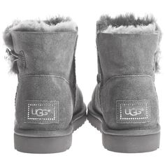 UGG Mini Bailey Button Bling Grey Buttoned lambskin boots ($265) ❤ liked on Polyvore featuring shoes, boots, ankle booties, uggs, accessories, lambskin boots, mini boots, button boots, ugg australia boots and sheepskin lined boots