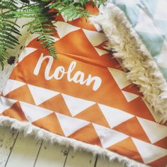 Personalized baby blanket in modern and trendy geo triangle design. Choose your own color combination for a custom look! Our stroller blankets are warm and cuddly soft! Use them in the stroller, carseat, at nap time or as a play mat. Use your personalized blanket in your newborn photoshoot to create a unique birth announcement! D E T A I L S ・ Dimensions are 28x34. ・ Top design is printed with Earth safe water-based ink on combed cotton. ・ Bottom layer is incredibly soft and cuddly ivory…