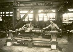 Men working in repair shop.
