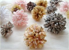 These are made out of old maps, newspapers, patterns, etc!!  Here are the steps to making these DIY Recycled Paper flower pom poms …wouldn't they look darling as cupcake toppers or strung together as a garland at a wedding or party!