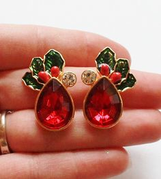 Vintage Avon Signed Christmas Holly Glass Rhinestone Clip Earrings by paststore on Etsy