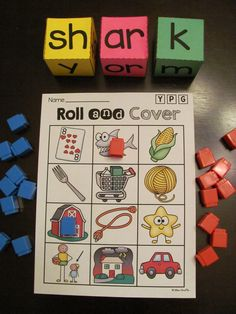 Bossy R words roll center! Students roll the dice to make OR and AR words and cover them on their gameboards! Super fun practice for R controlled vowels