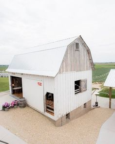 Our White Barn // Loft: Gift Table | Guest Book | Sitting Areas | Photo Booth // Lower Level: Bar | High Tops | Patio | Cafe Lighting | Bistro Tables & Chairs // These experiential spaces create multiple settings for your guests to enjoy. // Photo: @megandaas #legacyhillfarm
