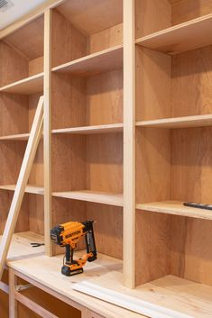 Adding poplar to the DIY bookshelves. We've been working on DIY built-ins for the last month. Here's how to build the bookshelves using plywood and poplar wood. This step-by-step tutorial walks you through everything to recreate this in your home. Wall Bookshelves, Shelves, Home Projects, Bookshelves Diy, Bookshelves Built In, Diy Shelves, Cool Bookshelves, Bookcase Diy, Plywood Shelves