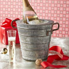 "AMES INSULATED WINE BUCKET�--�Double-walled for extra insulation, this galvanized iron bucket is lightly worn for a rich patina and ready to serve at gatherings year-round. Imported. 8-3/4"" dia. x 8-1/2""H."