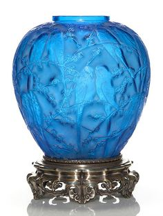 "Rene Lalique blue ""Perruches"" vase mounted upon an ornate silver metal base. Santa Fe Style, Chandeliers, Smart Art, Vases, Hood Ornaments, Diamond Gemstone, E Design, Vintage Antiques, Art Decor"