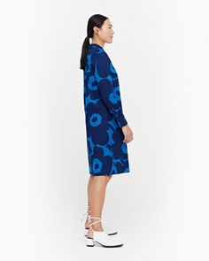 The A-line Ylväs dress is a classic button-up dress, which is made of cotton poplin in the Unikko (poppy) pattern. It has a detachable belt, side seam pockets and wide cuffs at the sleeve ends.Unikko (poppy) was born in 1964 after Armi Ratia, Marimekko, Blue Dresses, Dresses For Work, Poppy Pattern, Button Up Dress, Flower Patterns, Poplin, Dark Blue, Floral Prints