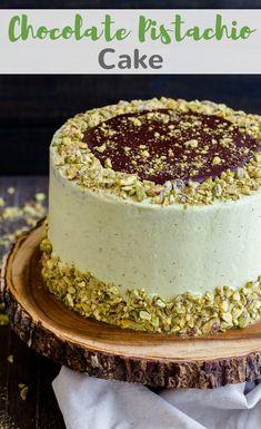 This layered Chocolate Pistachio Cake will turn heads! Rich decadent chocolate cake slathered in light, creamy pistachio frosting. #cake #chocolate #pistachio #dessert #baking via @introvertbaker