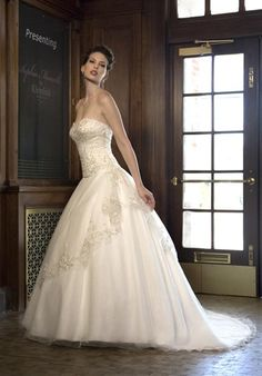 Sophia Moncelli for Kleinfeld   Gown features beading, embroidery, asymmetric overlay, and covered buttons down back.