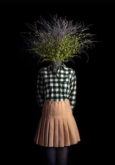 While we adored Miguel Vallinas' photographic series of people with animal heads, there is something I love so much about his latest series Roots. In place of human heads, the Madrid-based photographer has paired fashionably clothed bodies with botanical bouquets - each representing the stem