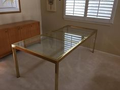 Mid-century brass and glass dining table