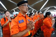 Rescue workers from a Buddhist organization pray for the passengers of Malaysia Airlines flight MH370 at Kuala Lumpur. Edgar Su/Reuters