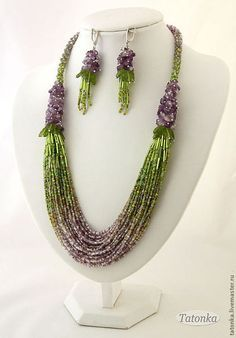 the length of necklace on the inner edge of ~ 63 cm, appearance ~ 68 cm. earrings length with fastener ~ 7.5 cm. 36- bead strands scored with a smooth transition of color from carefully selected complex mix Czech bead , comprising more than 30 colors and shades. The upper part of the necklace is made up of raw amethyst and Czech leaves on pins and completed thin plaits of a mixture of beads of those same colors as in the middle of the necklace .