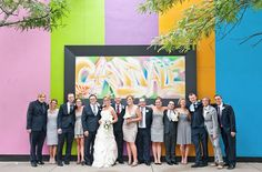 Carnivale's vibrant walls provide a kaleidoscopic backdrop for wedding photos.