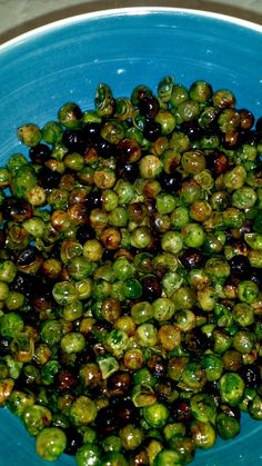 Roasted Peas with olive oil and salt. Thaw frozen peas overnight in fridge. Combine peas, oil and spices. Spread on baking sheet. Preheat to 375--bake 25 min.