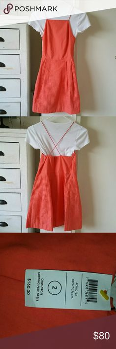 NWT Kate Spade Saturday Orange Dress Never worn with tags!  Fun, little party dress to brighten the event with.  Tshirt not included (just for styling).  Apron style neckline with elastic straps.  A-line skirt with pockets and perforated frayed squares for texture.  Just too short for me (5'6), if my height or taller need shorts underneath.  Need to wear backless bra or fitted tshirt like pic to not worry.  Kate Spade Saturday is discontinued so it's hard to find!  No damage or stains noted…