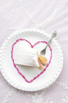 dress up a paper plate for Valentine's by lacing a ribbon in it