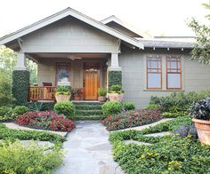 A lush garden adds interest to this home's simple entrance. More ways to I LOVE this!!!!  What an idea for my front yard!!!!    boost curb appeal: http://www.bhg.com/home-improvement/exteriors/curb-appeal/curb-appeal-on-a-dime/