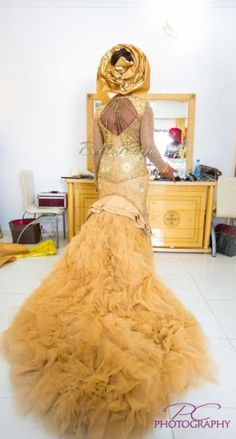 Long pretty yellow gold dress on Nigerian bride from Bella Naija weddings.