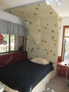 Check out this climbing wall on Craigslist that's built into the headboard of a bed.