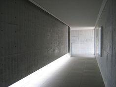 Beautiful lit corridor inside the Chichu Art Museum at Naoshima by Tadao Ando.