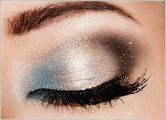 This awesome makeup look is made by using shimmery blue and silver eye shadows and is finished with a brown glittery eyeshadow at the ends. A very thin eyeliner and mascara was all that was needed to enhance this eye makeup look.