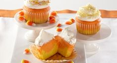 Candy Corn Cupcakes: Inspired by Halloweenandrsquo;s signature candy, these bright cupcakes feature vibrant layers of orange and yellow cake topped with creamy white frosting and sprinkles.