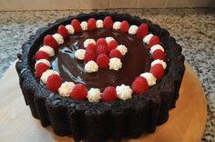 chocolate mary ann pan cake with ganache and raspberries