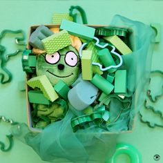 Green is our color of the month! Can your child find Og the Bookworm hiding in this very green picture?