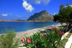 Idyllic beach Myrties with oleander and Telendos islet view. Greek Sea, Places In Greece, Beach Flowers, Channel, What A Wonderful World, Greece Travel, Greek Islands, Beautiful Beaches, Beautiful Landscapes