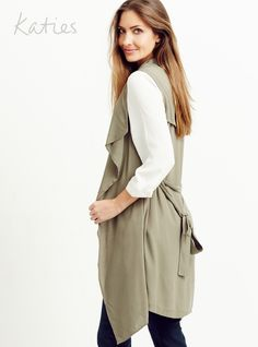 SLEEVELESS BELTED TRENCH / The must-have soft trench goes sleeveless for the ultimate multi-tasking piece. Look new season now by layering over a blouse or under a jacket and take your look from simple to stand-out. Trench, Layering, Must Haves, Seasons, Blouse, Simple, Coat, Winter, Jackets