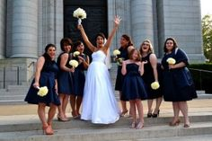 True to the Naval tradition, bridesmaids wore navy dresses and carried sweet yellow carnations.