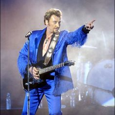 Johnny Hallyday - French superstar who gained fame singing US rock & roll hits en Français.