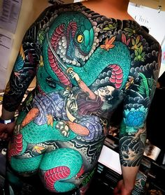 Japanese back tattoo by @kianforreal_horisumi. #japaneseink #japanesetattoo #irezumi #tebori #colortattoo #colorfultattoo #cooltattoo #largetattoo #backtattoo #legtattoo #armtattoo #tattoosleeve #snaketattoo #samuraitattoo #flowertattoo #peonytattoo #mapleleaftattoo #newschool #newschooltattoo #blackwork #blackink #blacktattoo #wavetattoo #naturetattoo