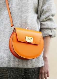 Orange Wristlet Circle Bag – The Frankie Shop Fashion Handbags, Tote Handbags, Fashion Bags, My Bags, Purses And Bags, Clutch Bag, Crossbody Bag, Leather Saddle Bags, Round Bag