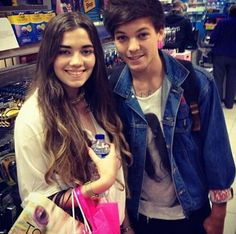 Louis with a fan today ... He looks sooo freakin adorable I can't even