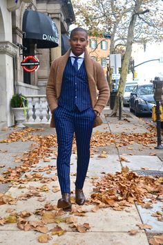 Sabir M. Peele of @MensStylePro rocking:    @CobblerUnion Guillaume II Boots   @Imparali Custom Chalk Stripe Waist Coat & Pants   @OnassisClothing Cardigan  Full feature - http://mensstylepro.com/2014/12/11/the-three-best-brown-boots-of-fw-14/   #style #menswear #suits #boots