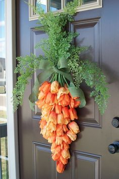 Spring Carrot Door Hanger Spring is upon us! I'm so excited for the sunshine, warm weather, flowers and all the happiness that spring brings with it. I'm also excited for Easter and spring time decorating and I've decided t… Spring Decoration, Diy Easter Decorations, Flower Decorations, Decorating For Easter, Easter Wreaths Diy, Easter Crafts To Make, Fall Door Decorations, Door Decorating, Decorating Ideas
