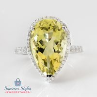 This shimmering yellow quartz ring may give the sun a run for its money! Which makes it the perfect accessory for a tropical vacation! || 8.00ct Pear Shape Lemon Quartz With .17ctw Round White Zircon Sterling Silver Ring