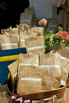 Wedding programmes - brown paper bags with the programme printed on. Inside is confetti to throw afterwards.