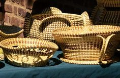"""""""Sewn"""" from sweet-smelling plants that line the Low country's marshes, these baskets were first made... - Sweetgrass Baskets"""