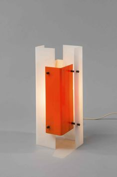 Lampe 316- Jean Boris Lacroix  Edition Luminalite- 1958        Métal laqué, plexiglas et laiton poli